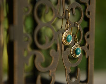Artisan crafted turquoise cabochon stone brass earrings