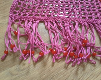 Shawl in pink cotton decorated with red glass beads.