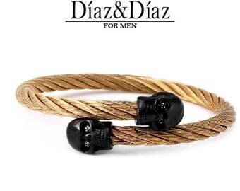 Bracelet black skulls and titanium gold wire
