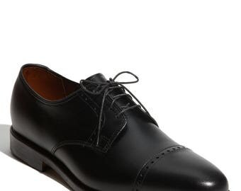 kalemfootwears - A black leather shoe with tread. Good for all cooperate events. Keeps comfortable till the end.