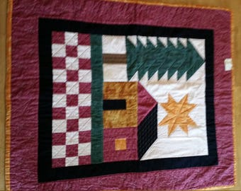 Quilted wall hanging entitled, 'Home,