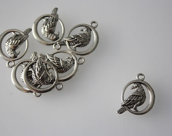 Set of 10 1.5 x 1.7 cm silver Parrot charms. For creating jewelry and other creations.