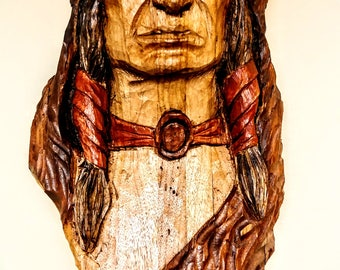 Hand carved American Indian wall hanging.