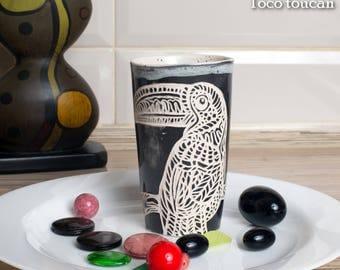 Handmade glazed ceramic mug cup for coffee and tea, carved toco toucan