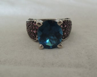 Delightful Blue Topaz and Amethyst set in Solid 925 Sterling silver. Previously owned In good condition