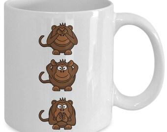 "Mug with 3 little monkeys illustrate the ""See no evil, hear no evil, speak no evil"" saying.  Cute 11 oz mug for your favorite tea or coffee."