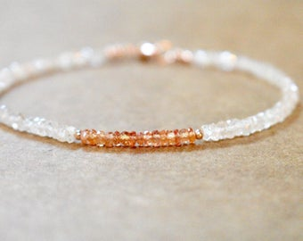 champagne zircon and padparadscha bracelet. delicate padparadscha and sparkly zircon gemstone bracelet. zircon and coral sapphire jewelry.