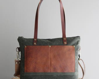 Medium Waxed Canvas Tote in  Navy with Cognac Leather Pockets and Handles Cross Body Strap