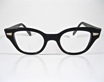 Horn rimmed black plastic eyeglasses. 1950s Bausch and Lomb men's unisex browline thick frames.