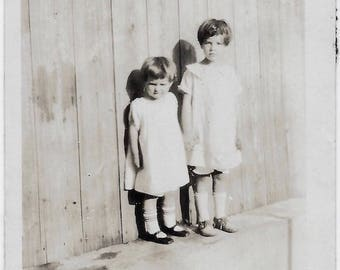 Old Photo 2 Girls wearing Dresses Wood Fence 1920s Photograph Snapshot vintage