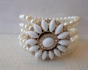 5 Row Stretch Cuff Bracelet in White Sea Shell Pearls and a White Daisy Charm Center with Clear Rhinestones