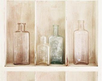 Antique glass bottles - vertical printed photograph
