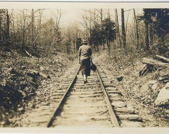 Woman walking down train track, Vintage photograph c1930s
