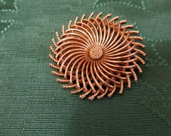 Lovely Trifari brooch in gold tone metal with a swirl design