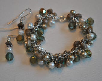 Petoskey Stone sterling silver dangle bracelet set with white pearls and green crystals, Lake Michigan Bracelet,  charm bracelet