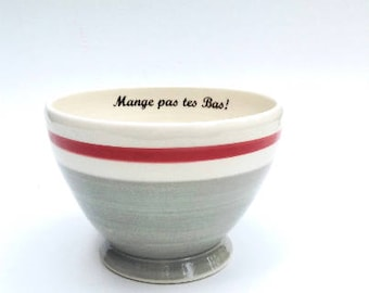 Cafe au lait bowls with inscription «mange pas tes bas» pattern of gray wool socks with red border.with inscription
