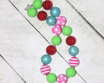 Christmas chunky bubblegum necklace in red pink lime green and red beads for girls. Birthday whimsical necklace for toddler girl. Rhinestone