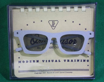 Vintage scarce 1947 Bausch & Lomb 3-D  Polaroid  Training glasses and manual with celluloid 3 -D plates in original presentation box.