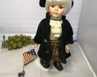 H002 Ben Franklin porcelain doll with coat,hat and kite Vintage