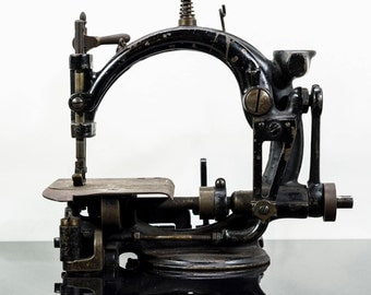 Small Primitive Sewing Machine, All Metal Estimated to be Late 19th Century