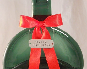 Dark Green Melted Bottle Festive Art with a bright Red Ribbon and small Silver Plaque saying Happy Holidays offered by Crafts by the Sea