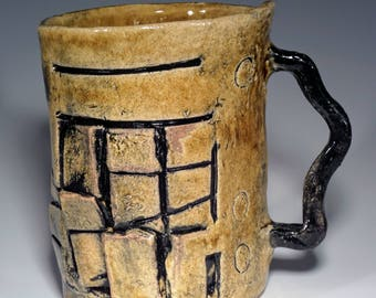 Unique Tilted mug.  Functional art to stimulate your day.  Textured and tactile, for coffee, tea or what have you!