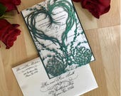 laser cut pinecone winter wedding invitation gatefold paper heart grapevine wreath and berries fall rustic forest