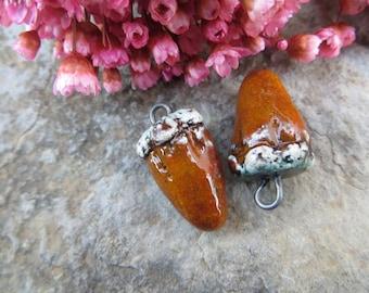 2 antique charms beads...  ethnic ceramic Moo creator. antique... molten lava. Unique and handmade