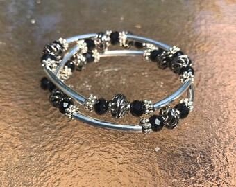 Black crystal and silver metal spiral wire wrap bracelet