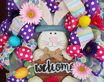 """16""""  Easter bunny wreath in purples, pinks , and pastel rainbow mesh"""