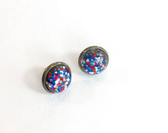 Stud earrings. Red white and blue earrings. Glitter earrings. Glitter resin stud earrings. American holiday jewelry. Fourth of July jewelry.