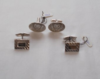 Two Pair of silver tone men's cuff links.  (739)
