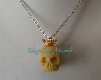 A Royal Death Resin Human Skull Necklace with Small Gold Crown Tiara on Silver, Bronze or Gold Crossed Chain or Black Faux Suede Cord