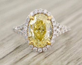 Fancy Yellow Oval Brilliant in a True French Pavé Halo Diamond Stem Engagement Ring in White
