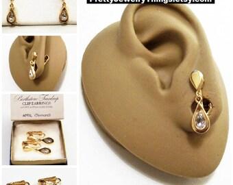 Avon Clear Crystal Teardrop Clip On Earrings Gold Vintage 1977 Austrian Glass April Diamond Birthstone Glass Stone Bezel Set Wide Band Edge