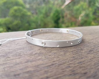 Sterling silver bangle with silver and bronze rivets (medium)