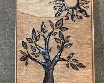 Tree and sun wood burning art
