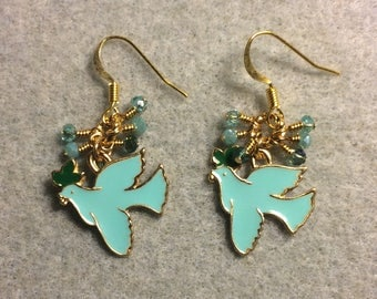 Turquoise, green, and gold enamel dove charm earrings adorned with tiny dangling turquoise and teal Chinese crystal beads.