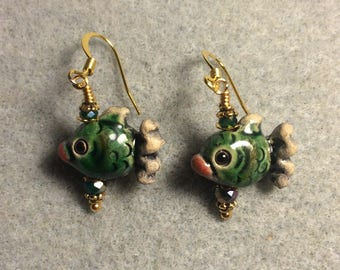 Small dark green, tan and red ceramic fish bead earrings adorned with dark green Chinese crystal beads.