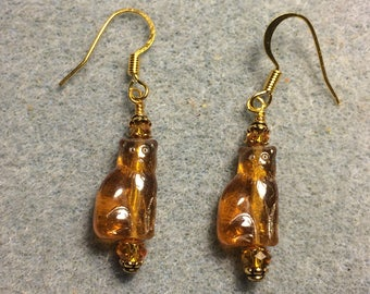 Small translucent amber Czech glass cat bead earrings adorned with amber Czech glass beads.