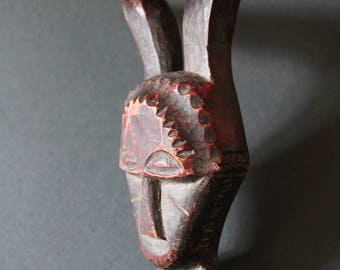 Baule tribe passport mask, tribal used from the Cote d'Ivoire, red brown colour patina. Zoomorphic with scrification