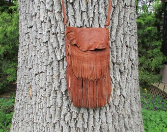 Brown leather bag with fringe