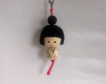 Kokeshi red, mounted on a steel lobster clasp