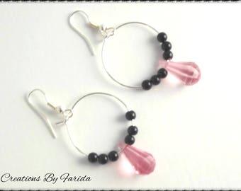 Hoop earrings with multifaceted pink Teardrop bead and black beads