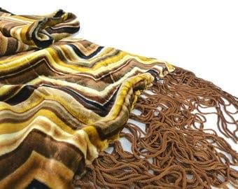 Oscar de la Renta oblong chevron silk velvet scarf. Golds & browns with copper brown tassel fringe ends. Sheer crepe lining.