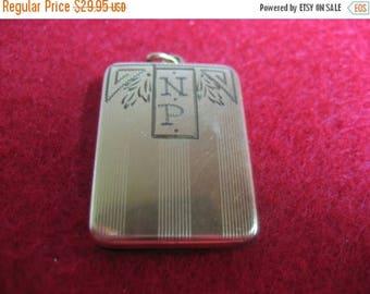 ON SALE Very unusual thin vintage locket, Marked P&K inside