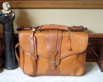 Dooney & Bourke Tan  All Weather Pebbled Leather Briefcase With Brass Hardware And Adjustable Shoulder Strap- EUC