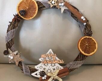 Pretty decorative Christmas wreath in branches