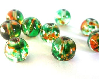 10 transparent beads, orange and green 8mm round glass