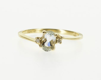 10k Blue Topaz Diamond Accented Three Stone Bypass Ring Gold